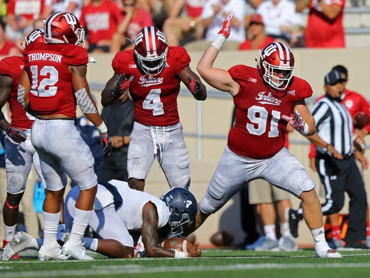 Sep 23, 2017; Bloomington, IN, USA; Indiana Hoosiers linebacker Chris Covington (4) and defensive lineman Jacob Robinson (91) react after a defensive stop against Georgia Southern Eagles quarterback Shai Werts (4) in the first half at Memorial Stadium. Mandatory Credit: Aaron Doster-USA TODAY Sports