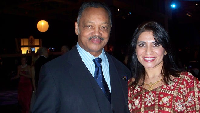 Jesse Jackson, seen here with Dr. Mona Khanna at the 2008 inauguration of President Barrack Obama, showed no signs of having Parkinson's disease. He says he developed signs seven years later, at the age of 69.