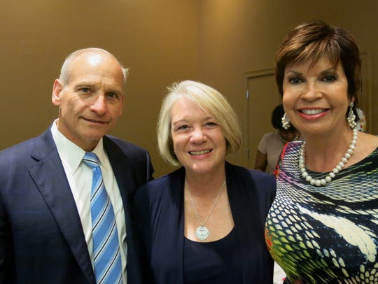 "U.S. Air Force Gen. (Ret.) Jim Kowalski and wife Julie Kowalski and Linda Biernacki were among silent auction bidders at ""Chocolate & Champagne."""