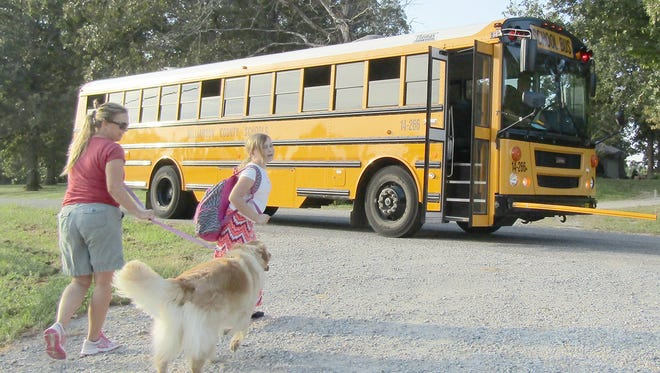 Fairview mom Shannon Lookenott walks her daughter Delaney to catch the bus each morning around 8 a.m. That could change to 7 a.m. if Williamson County Schools decide to change school start times.