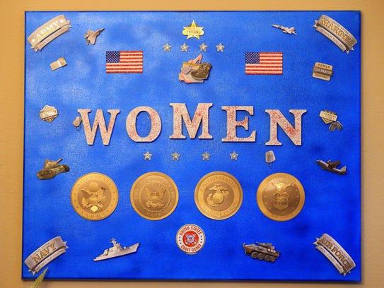 Art work hangs in Navy veteran LeeAnn Fox's home on