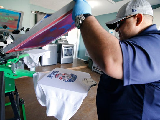 """Tony Mercado, owner of Markit.GnA cranks the """"Dia de Los Dodgers"""" t-shirts in his Northeast El Paso home. Mercado got the idea when the Dodgers made the World Series when he remembered that the final game is on Day of the Dead if the series goes seven games. His shirts are available at Facebook.com/MarkitGnA."""