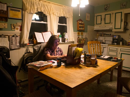 Lori Alberts uses her computer in her makeshift office at her home in Smyrna to write letters to about 75 inmates a month. Alberts runs Link of Love, a support group for prisoners and their families.