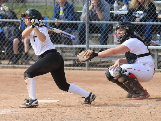 Plymouth's Jessica Tucci takes a cut during Wednesday's
