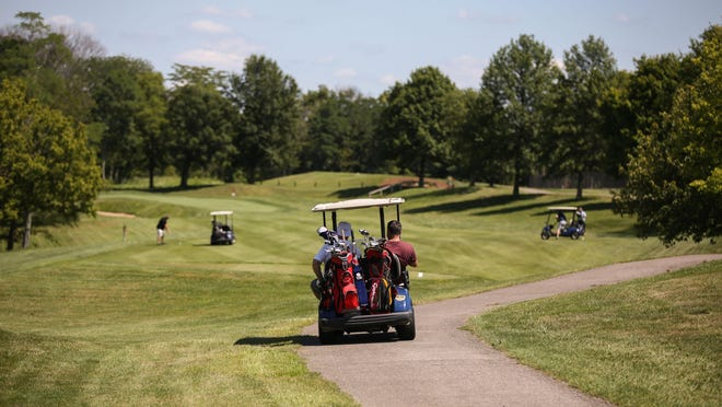 Players ride along the Fox Run course at the Kenton County Gold Course in Independence, Kentucky, Thursday August 13, 2015.