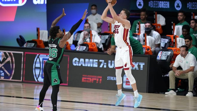 Miami Heat forward Duncan Robinson shoots over Celtics guard Marcus Smart during the second half of Game 1 of the Eastern Conference Finals on Sept. 15 in Lake Buena Vista, Fla.