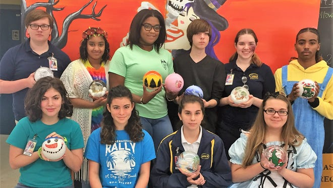 Art students at the Magnet Academy of Cultural Arts in Opelousas decorated ornaments for a tree in President's Park at the White House.