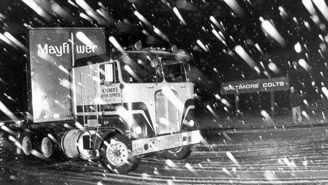 A moving van carrying the Baltimore Colts' equipment leaves Baltimore for Indianapolis in the middle of the night in this March 19, 1984 file photo.