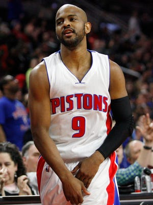 Detroit Pistons guard John Lucas III reacts after making a buzzer beater just inside halfcourt against the San Antonio Spurs at the Palace of Auburn Hills.