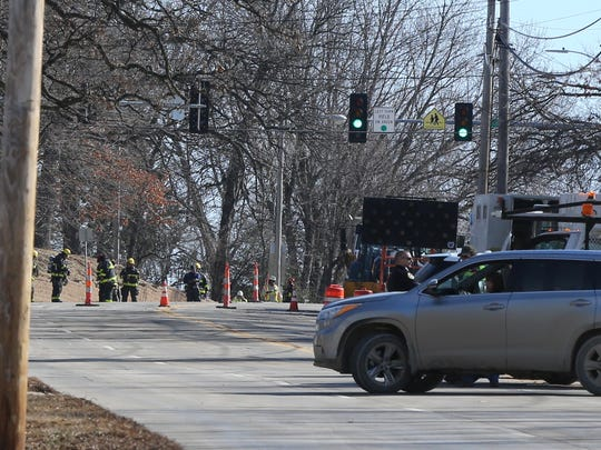 Workers on the scene of a gas leak at 56th Street and Grand Avenue in Des Moines Tuesday, Feb. 27, 2018.