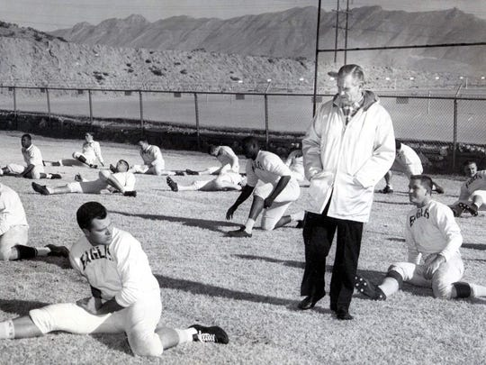 "The original caption on this 1959 file photo: ""Chief Coach Odus Mitchell of North Texas State Eagles walks among his boys in the shadows of the Franklin Mountains as his outfit prepares for their Dec. 31 clash in the Sun Bowl with the New Mexico Aggies of Las Cruces."""
