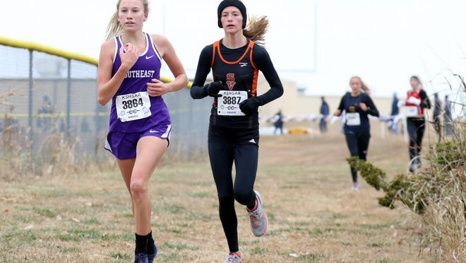 Southeast of Saline junior Jentrie Alderson leads Smoky Valley's Gracie Lambert during last week's Class 3A regional cross country meet at Southeast. Alderson will try to defend her 3A state championship on Saturday in Wamego.