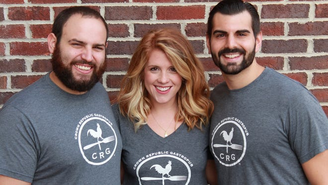 left to right: Mike Casari, Haleyrose Nutter-Sitek and Anthony Sitek, owners of Crown Republic in Downtown Cincinnati