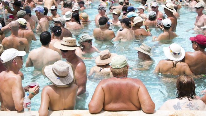 The pool is packed with nude bodies as skinny dippers from all over the nation try to break the record for largest number of skinny dippers at Shangri La Ranch in New River on Saturday, July 11, 2015.
