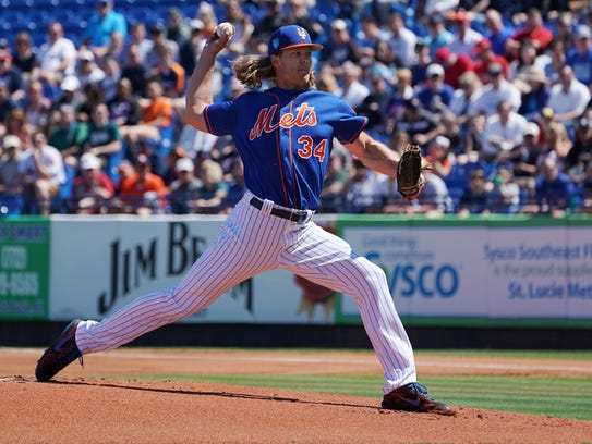 Mets starting pitcher Noah Syndergaard delivers a pitch