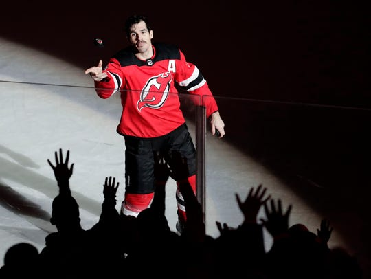 New Jersey Devils center Brian Boyle throws a puck