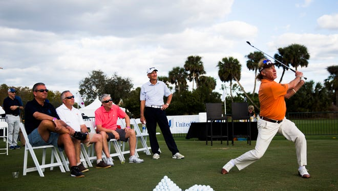 Miguel Angel JimeŽnez demonstrates a few different stances while giving a clinic during the Chubb Classic on Thursday at the TwinEagles Club in Naples
