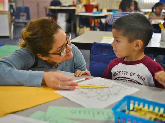 Griselda Gallardo talks to her son Julius, 4, before school starts at Rocky Hill in Exeter. Hundreds of students went back to school Thursday in Exeter, including several hundred who returned to Rocky Hill Elementary School. More photos at  www.VisaliaTimesDelta.com.