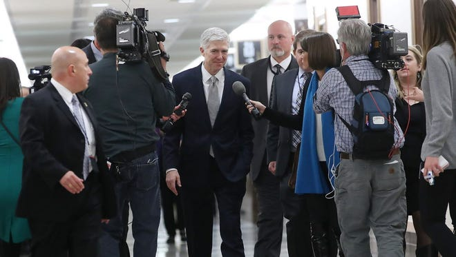 Judge Neil Gorsuch visits the Senate on Feb. 9, 2017.