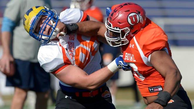 North squad tight end Nick Boyle of Delaware battles defensive end Nate Orchard of Utah during Senior Bowl North squad practice.