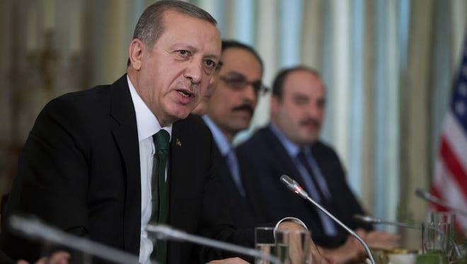 Turkish President Recep Tayyip Erdogan speaks during a bilateral meeting with President Obama in Paris on Dec. 1.