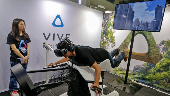 Trying a virtual reality headset in Taipei, Taiwan, on June 1, 2016.