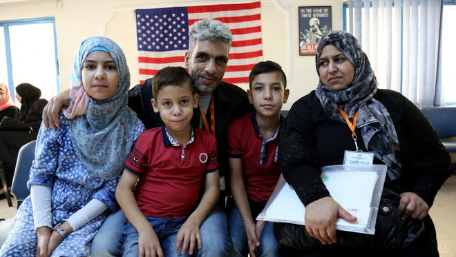 AMMAN, Jordan _ In this photo taken Sunday, August 28, 2016, five members of the Jouriyeh family, Syrian refugees headed to the U.S. as part of a resettlement program, pose for a photo in the Amman, Jordan office of the International Organization for Migration. The family members are Nadim Fawzi Jouriyeh, 49; his wife Rajaa Abdo Altaleb, 42; their daughter Hanan, 13; their son Farouq, 8 (foreground); and their son Hamzeh, 12. The Jouriyeh family will head to San Diego, California, as part of a year-long program to resettle 10,000 Syrian refugees in the United States.
