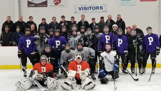 Players on the Plymouth Wildcats varsity boys hockey team enjoyed a rare opportunity to go on a 'father-son' weekend. A number of dads joined their sons for morning skates Dec. 1-2 in Grand Rapids.