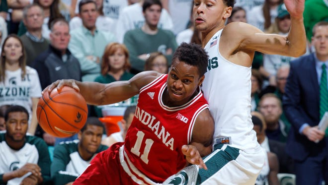 Indiana's Kevin Yogi Ferrell (11) drives against Michigan State's Bryn Forbes during the first half of an NCAA college basketball game, Sunday, Feb. 14, 2016, in East Lansing, Mich. (AP Photo/Al Goldis)