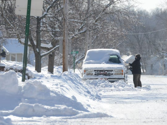 Residents begin the process of digging out following the first major snow storm on Monday, Feb 2, 2015.