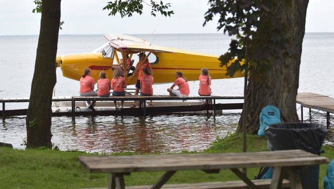 Teenagers participate in a seminar at the Oshkosh Seaplane Base, located south of Oshkosh, near Highway 45 and Koelpin Road.