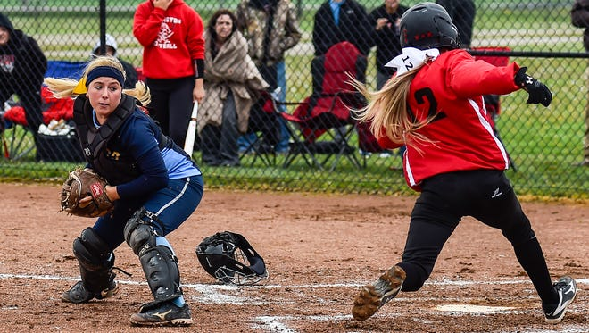 Cardington's Brooklyn Whitt scores during a game at River Valley last season. The Pirates again won the MOAC Blue Division championship in softball.