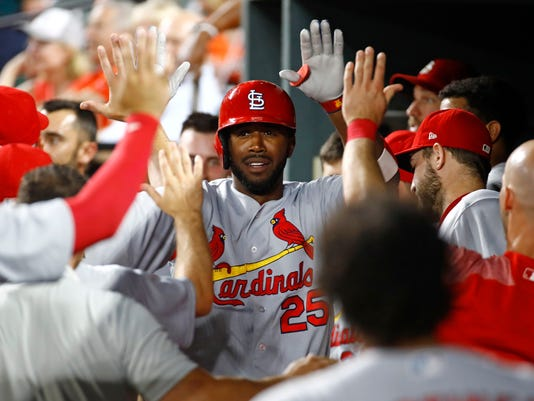 St. Louis Cardinals' Dexter Fowler, center, high-fives as he celebrates in the dugout after hitting a solo home run in the sixth inning of an interleague baseball game against the Baltimore Orioles in Baltimore, Friday, June 16, 2017. (AP Photo/Patrick Semansky)