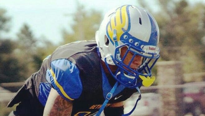 Enka alum Drake Wells now plays college football at Bethany (Kansas).