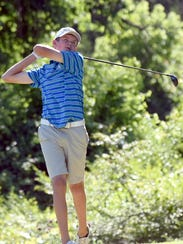 Bryce Lewis of Hendersonville watches a tee shot during
