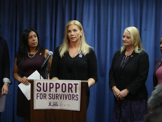 Nichole Beverly a domestic violence survivor, speaks