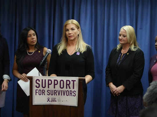 Nichole Beverly a domestic violence survivor, speaks during a press conference held by the Michigan Progressive Women's Caucus' Gender Violence Task Force to introduce a package of bills meant to address gaps in state law to better support survivors of gender and domestic violence Thursday, November 9, 2017 at Anderson House building in Lansing, MI.