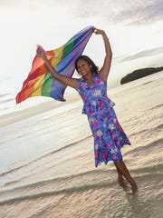 ISA Guam Founder and Chairwoman Lasia Casil lets the LGBT pride flag fly in the breeze at Alupang Beach in Tamuning on June 22, 2016.