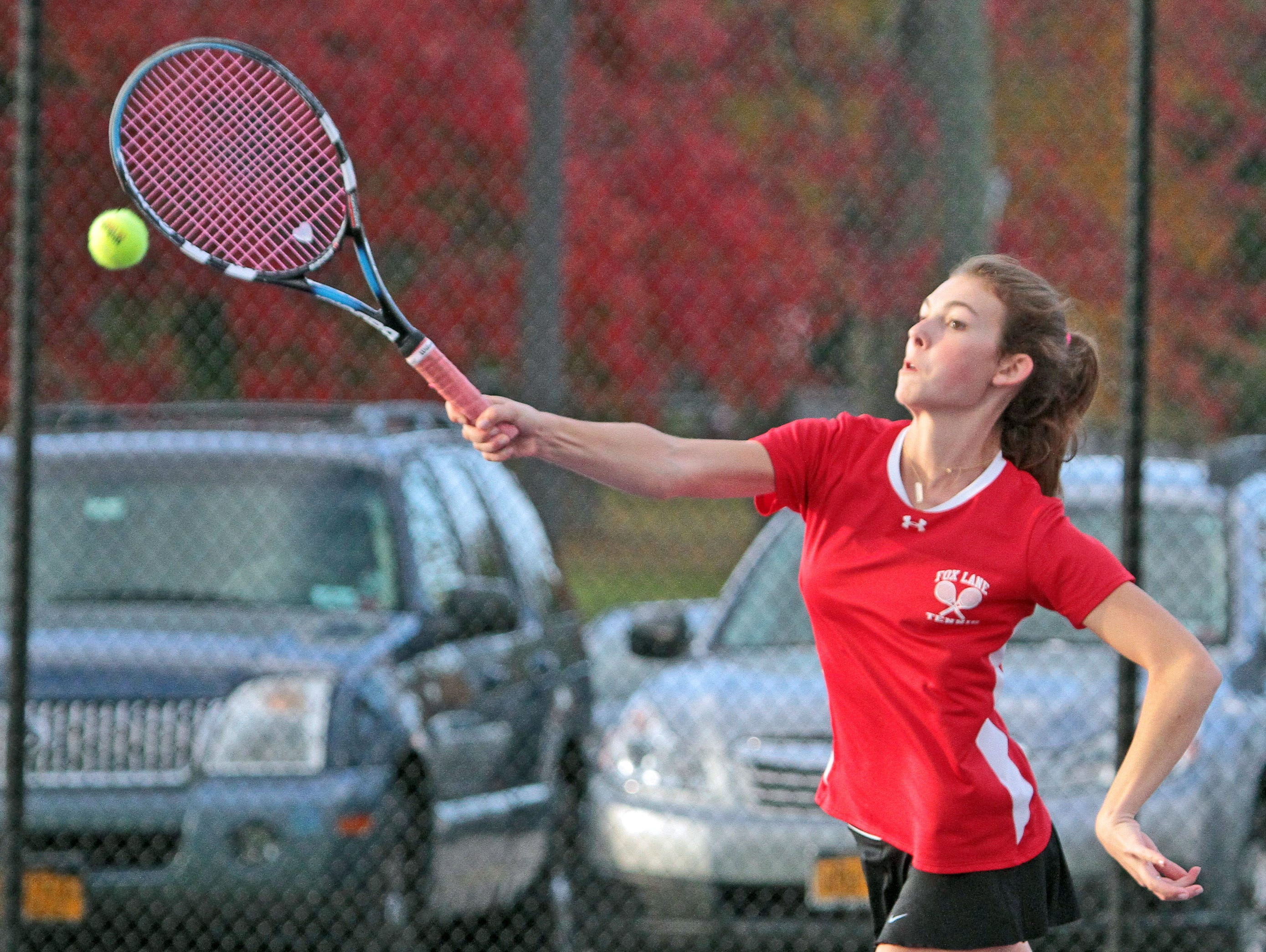 Lachlan Spence of Fox Lane returns a shot during a doubles match during the high school tennis championships at John Jay Cross River Oct. 13, 2015. Spence and her teammate Abby Bayuk were playing a team from Yorktown.