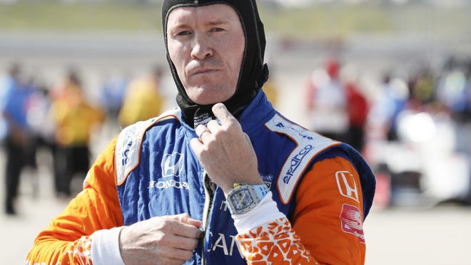 Scott Dixon gets ready for qualifying for an IndyCar Series race at Iowa Speedway last July.