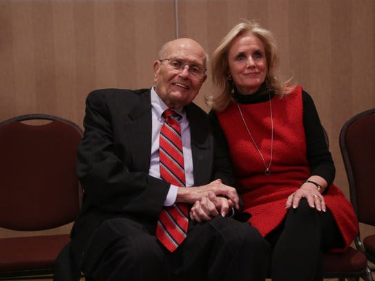 In this 2014 file photo, then-U.S. Rep. John Dingell and his wife, Debbie Dingell, pose for a photo after John Dingell addressed his retirement. Debbie Dingell succeeded him that seat.
