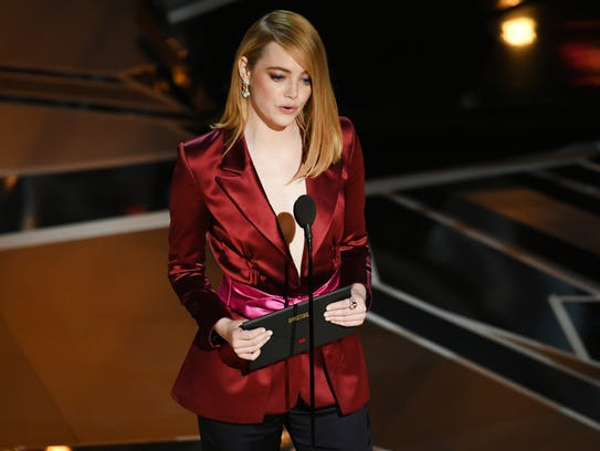 Emma Stone speaks onstage during the 90th Annual Academy