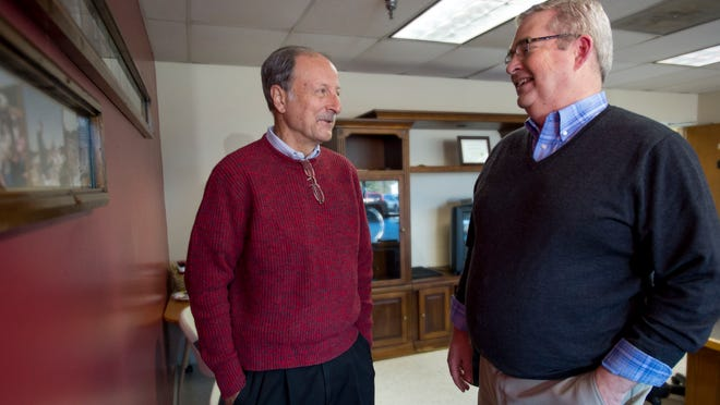Jack Heath, left, former CEO of Lower Shore Enterprises, left, speaks with new CEO Bill Turner in this photo from 2015.