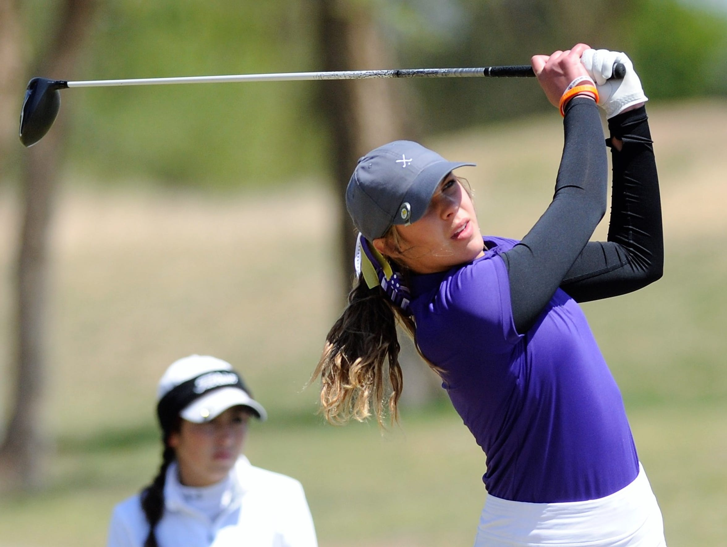 Wylie's Maddi Olson tees off during the first round