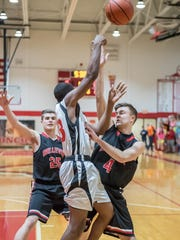 Bellevue's Cody Rugg (25) and Dawson Morgan put on defensive pressure during first round action against Benton Harbor Dream Academy in regional tournament play Wednesday evening.