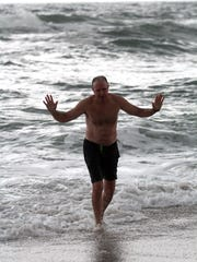 Island Heights resident Doug Maday finishes a swim in the Seaside Park surf late Friday afternoon, December 5, 2014. He's been jumping into the ocean every day for three months and plans to continue through the end of winter to raise money for ALS research. SEASIDE PARK, NJ MADAY1205D ASB 1209 Carino Column PHOTO BY THOMAS P. COSTELLO / STAFF PHOTOGRAPHER