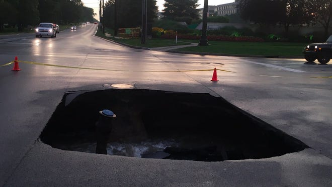 A large sinkhole caused by a water break opened at the intersection of 96th Street and College Avenue in College on Thursday night. It has since been repaired.