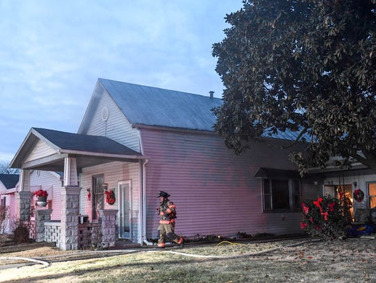 Evansville city firefighters at the scene of a working