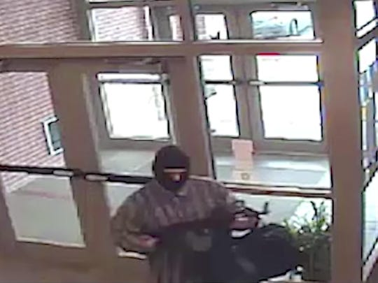 This undated image from surveillance video released by the FBI shows the suspect known as the AK-47 Bandit. Richard Gathercole of Roundup was sentenced in federal court in Nebraska to 35 years in prison.