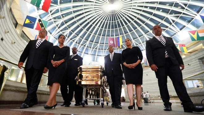 The casket of legendary singer Aretha Franklin is moved from the Charles H. Wright Museum of African American History in Detroit, Wednesday, Aug. 29, 2018. Franklin died Aug. 16, 2018 of pancreatic cancer at the age of 76.
